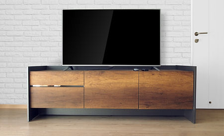 Led TV on TV stand in empty room with wh