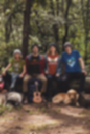 mockup-of-four-friends-at-a-campsite-wea