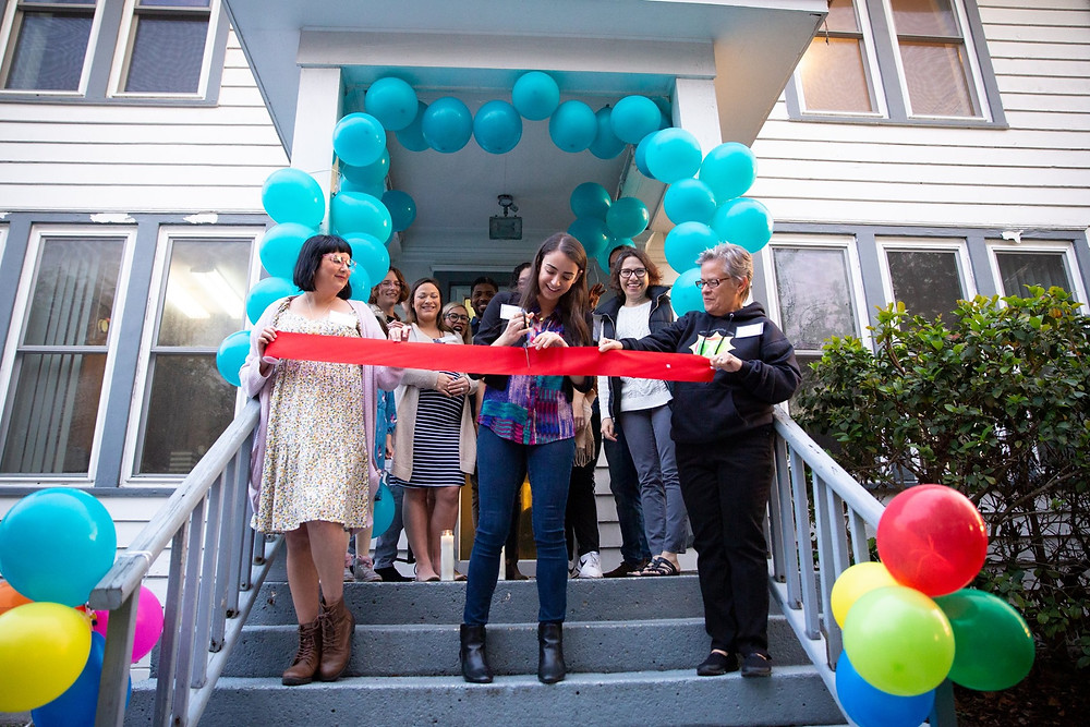 Ribbon cutting ceremony at Peer Support Space Anniversary Celebration. Photo by JD Castro.