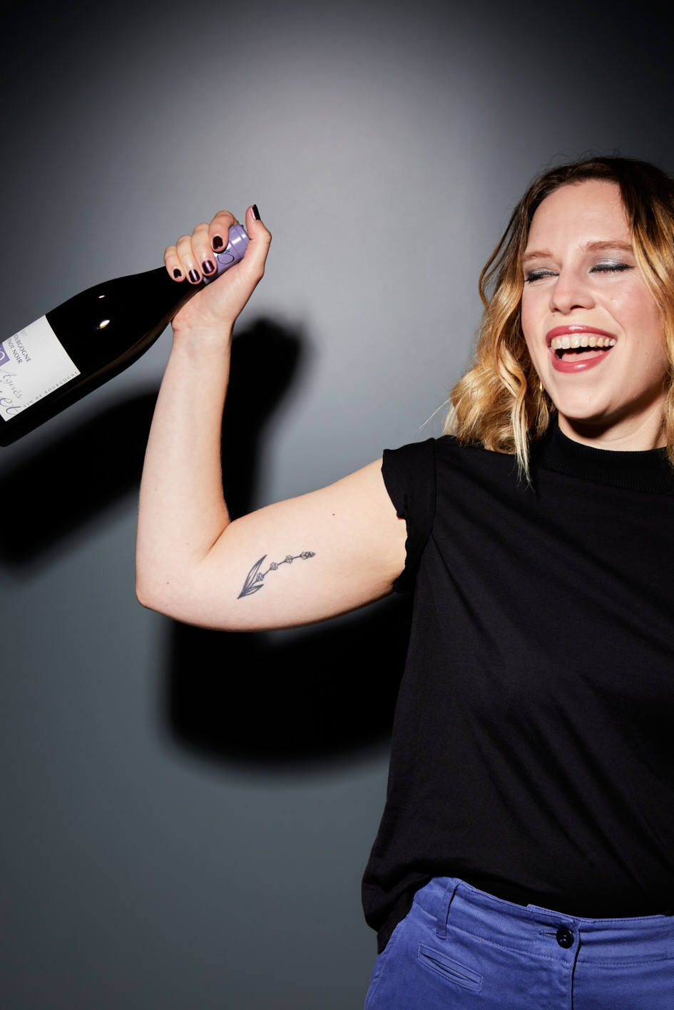 Ally with a bottle of Agnes Paquet Pinot Noir. Photo by: Patricia Niven    Food Styling: Loïc Parisot