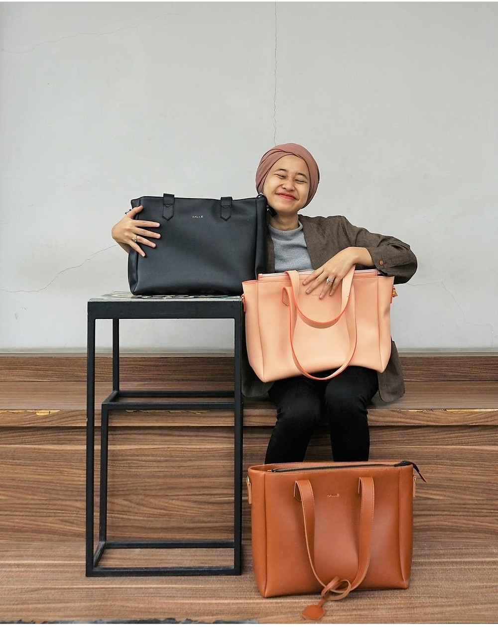 Malika Rizqia Anindita co-founder of Kalle with her Kalle bags. for Toastee Mag.