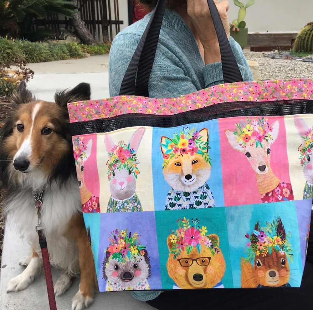 Lucia's Sheltie, Candy, with her Forest Friends tote bag. The fabric was designed by Mia Charro.
