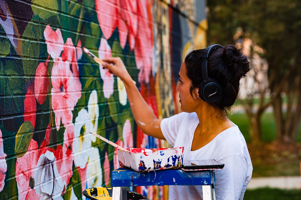 Irisol at work on her Climate Change Mural. Photographer: Brook Brown Photography.