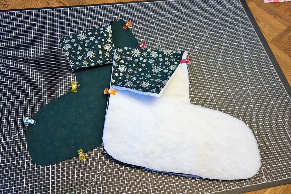 Pin the outside fabric to the layer fleece. This will add puffiness to your stocking.
