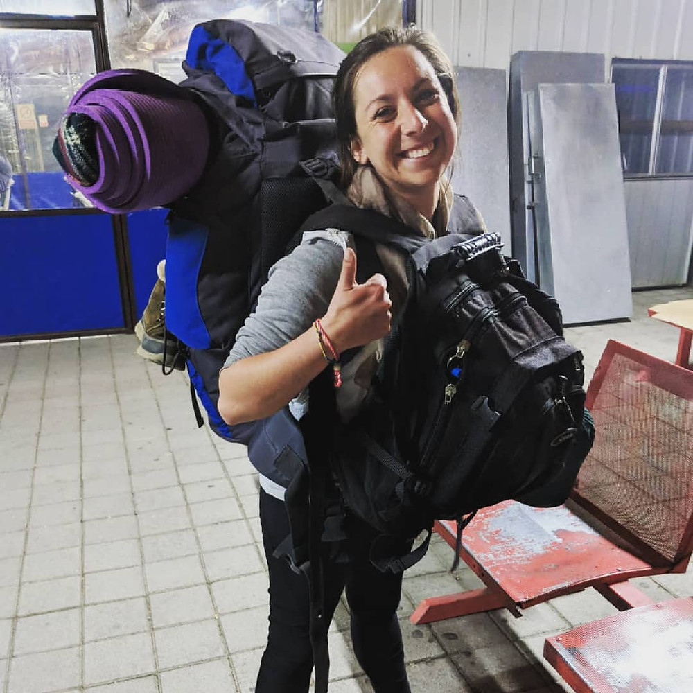 Jes Baily of Crowdfund 360 with her bags living the digital nomad life.