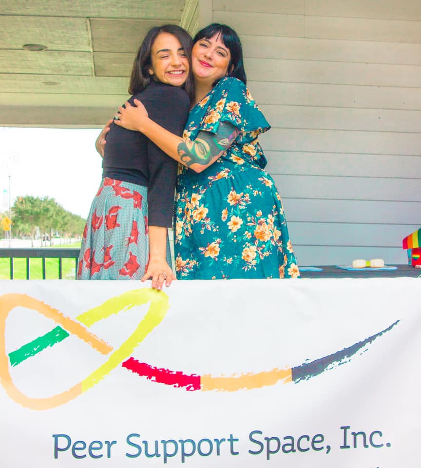 Yasmin (left) with Peer Support Space Co-founder Dandelion Hill (they/them) (right).