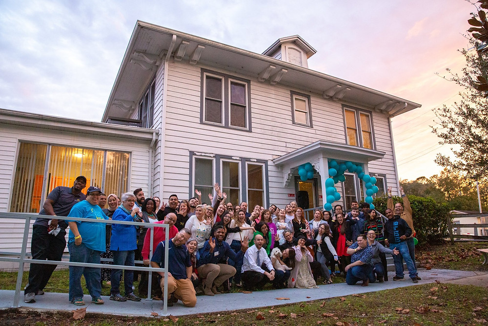 Group photo from Peer Support Space's Open House Celebration. Photo by JD Castro.