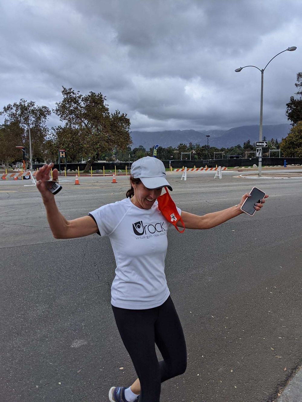 Stacey Sharp femal founder of Urock Fit Zoom gym at the finish line of her Urock style Tri.