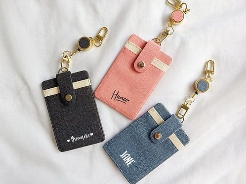 RETRACTABLE CARD HOLDER