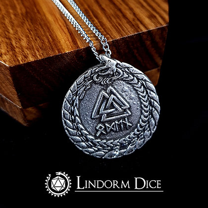 "Lindorm medallion with runes saying ""Odin"""