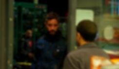 Ibrahim looks at Amir at the door אמיר ו