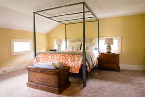 Bed in a yellow room in the Catskills