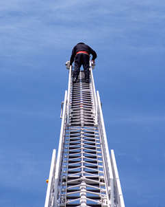 Man climbing a ladder to know where in upstate New York