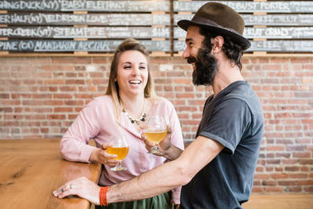 Couple drinking beer in a bar in upstate New York