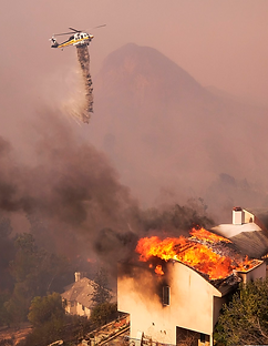 Helo Dropping water onto wildfire