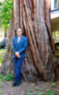 Man standing against 300 year old Cedar in Tahoe Basin