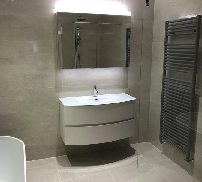 grey bathroom with wet room
