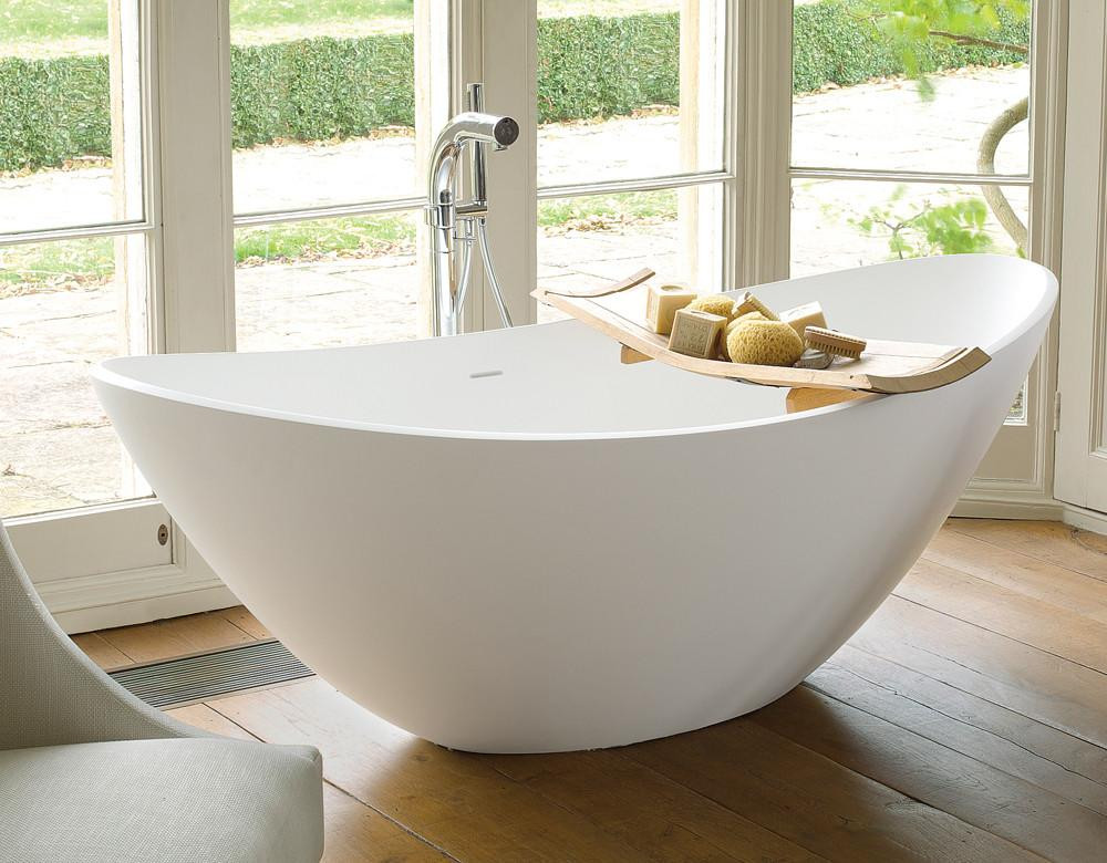 Breeze freestanding limestone bath