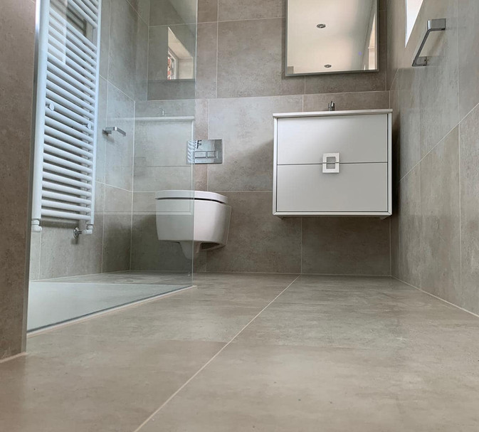 taupe tiles with wall mounted basin