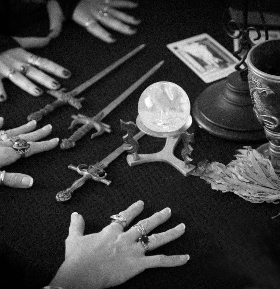 seance_table_hands_rt.jpg
