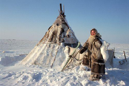 Oksana, Nenets woman carrying an arctic hare outside