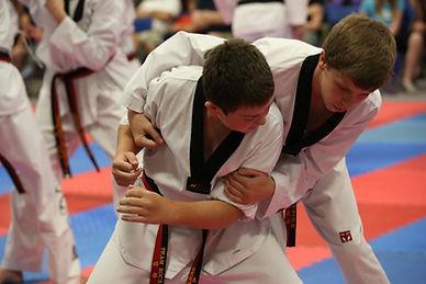 Littleton CO Martial Arts, The ROCK Martial Arts & Fitness, Tiger Self Defense, taekwondo bear hug defense, ages 7-12