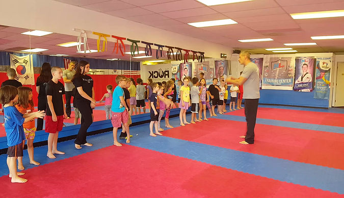 Power CATS participants learn assertive behavior and how to use their body language and voice to defend themselves.