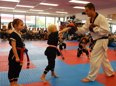 Littleton CO Martial Arts, The ROCK Martial Arts & Fitness, Little Ninjas Punching, youth taekwondo class