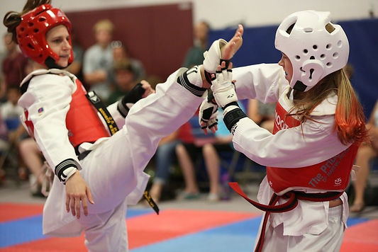 Littleton CO Martial Arts, The ROCK Martial Arts & Fitness, Taekwondo Olympic taekwondo Sparring Girls, axe kick