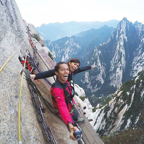 kim and bam standing in the wooden plank of Mount Hua in Shaanxi, China