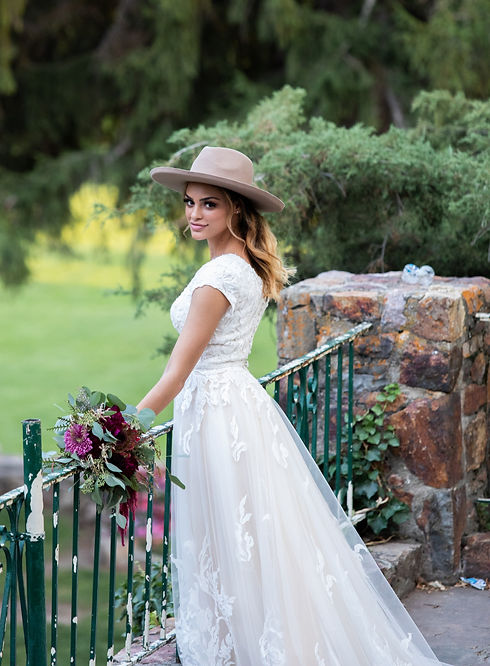 bride-to-be wearing a hat