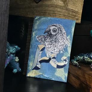 Textural papercut metallic monogram with bird