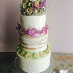 Medium 3 tier cake with middle tier semi naked