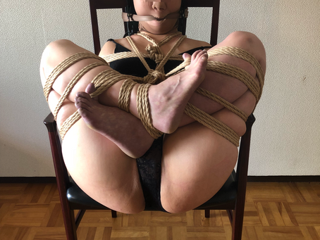 アンティークの椅子に固定、からの箱づめ/Strapped to an antique chair, then trapped inside of a box.