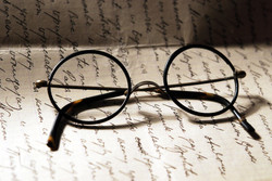 Old glasses on a handwrited letter