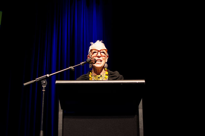 Founder of OzHarvest, Ronni Kahn speaking at a podium