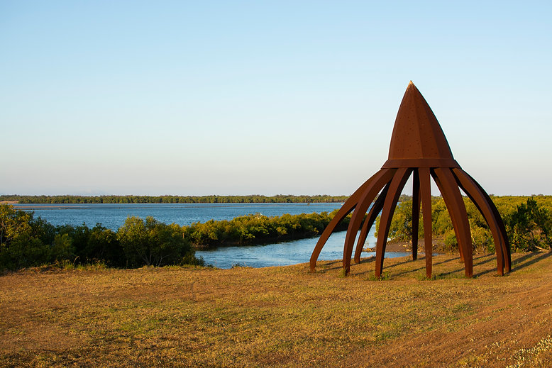 A sculpture on Sandfly Creek Walkway facing the water in Mackay. It resembles a flayed pen cap.