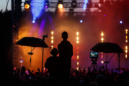 silhouette group of cameramen at an even