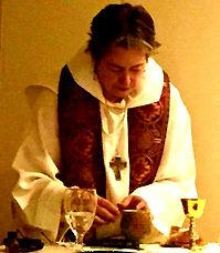 Cait celebrating Eucharist for community