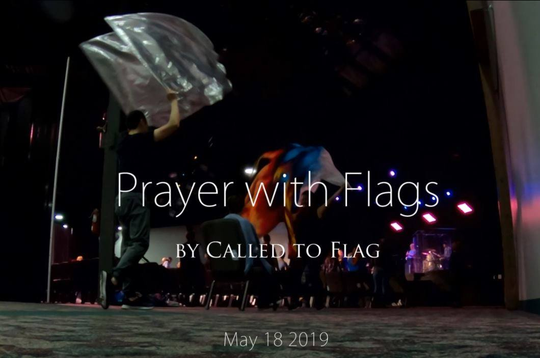 Prayer with flags by Called to Flag Dianne Paul at Catch the Fire Church Toronto