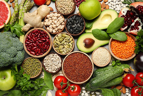 Different vegetables, seeds and fruits on grey table, flat lay. Healthy diet.jpg