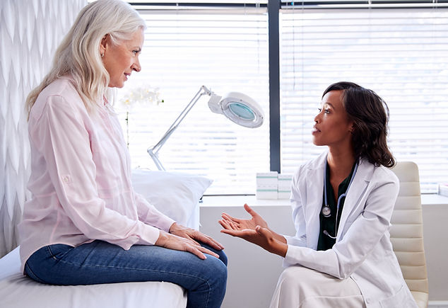 Mature Woman In Consultation With Female