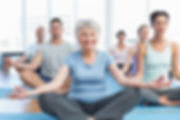 Elderly person doing yoga