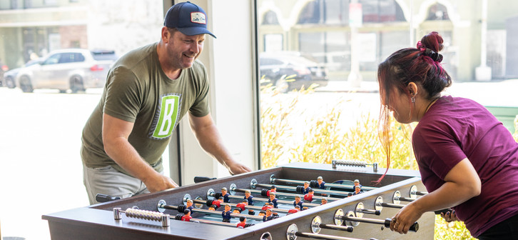 Two people playing foosball