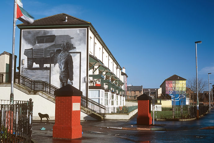 'The Rioter' with 'Peace Mural' in the distance - The Bogside Artists