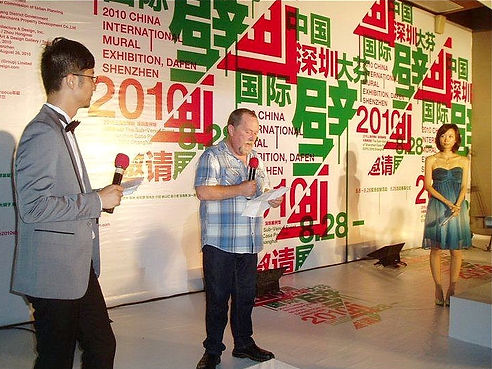 Tom Kelly on stage in Dafen, China