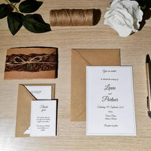 Rustic invitations with lace string band and gold leaf detail
