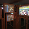 Audience wander between panels of film screens