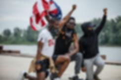 Men kneeling patriotic .jpeg