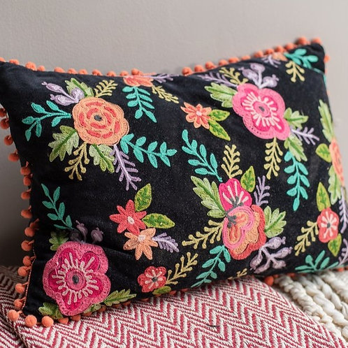 Floral cushion cover with small orange pom poms
